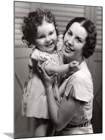 Mother and Young Daughter Hugging-George Marks-Mounted Photographic Print