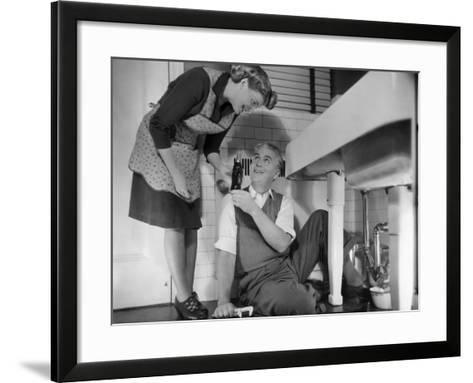 Mature Couple Fixing Kitchen Plumbing-George Marks-Framed Art Print