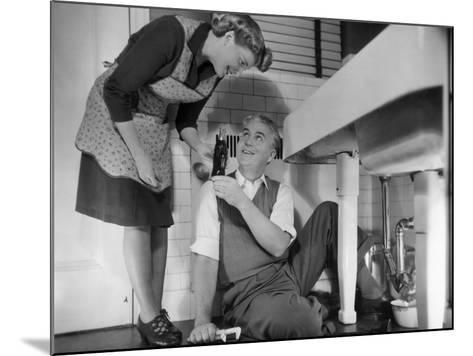 Mature Couple Fixing Kitchen Plumbing-George Marks-Mounted Photographic Print