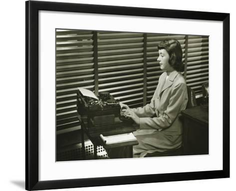 Secretary Typing on Typewriter in Office-George Marks-Framed Art Print