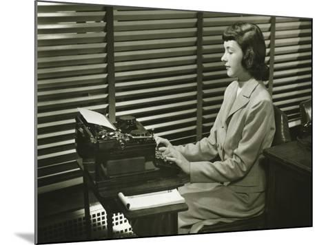 Secretary Typing on Typewriter in Office-George Marks-Mounted Photographic Print