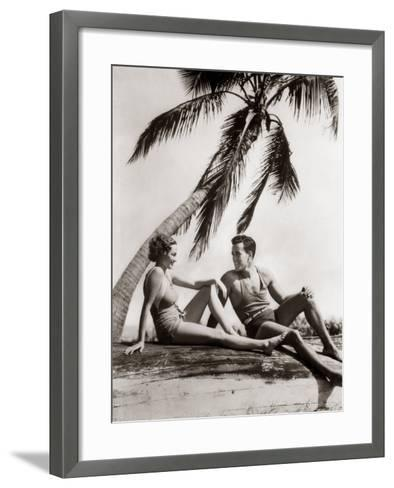 Smiling Couple Under Palm Tree Bathing-H^ Armstrong Roberts-Framed Art Print