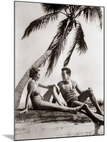 Smiling Couple Under Palm Tree Bathing-H^ Armstrong Roberts-Mounted Photographic Print