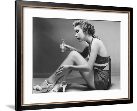 Woman Applying Cosmetic on Calf-George Marks-Framed Art Print