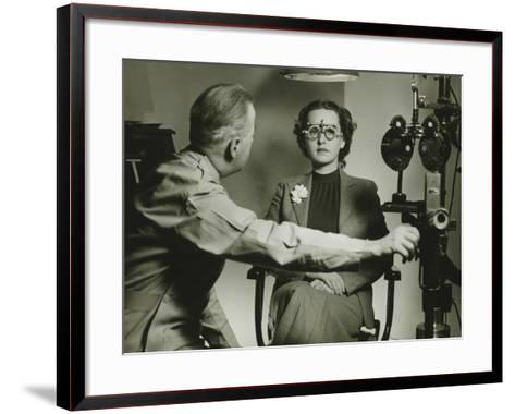 Optician Examining Patient's Eyes-George Marks-Framed Art Print