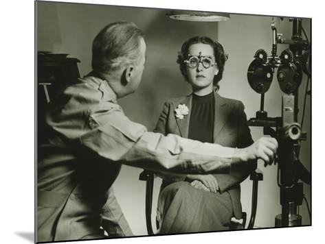 Optician Examining Patient's Eyes-George Marks-Mounted Photographic Print