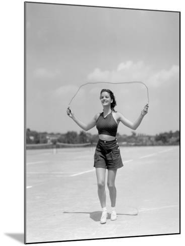 Smiling Teenage Woman Jumping Rope For Exercise Wearing Shorts and Polka Dot Halter Top-H^ Armstrong Roberts-Mounted Photographic Print
