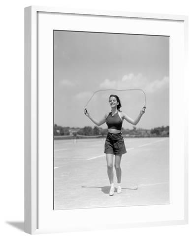 Smiling Teenage Woman Jumping Rope For Exercise Wearing Shorts and Polka Dot Halter Top-H^ Armstrong Roberts-Framed Art Print