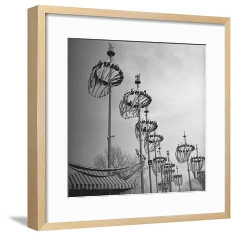 Decorations on Poles-George Marks-Framed Art Print