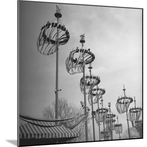 Decorations on Poles-George Marks-Mounted Photographic Print