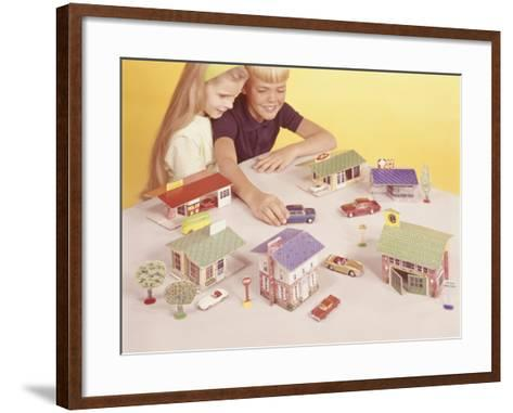 Boy and Girl (8-9) Playing With Doll Houses and Cars, Elevated View-George Marks-Framed Art Print