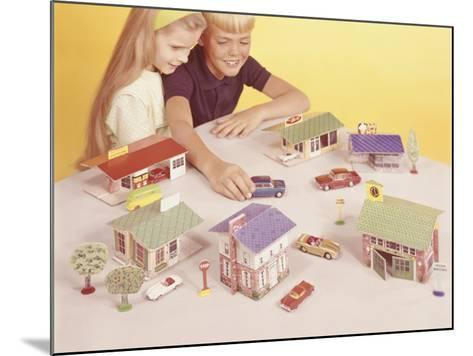 Boy and Girl (8-9) Playing With Doll Houses and Cars, Elevated View-George Marks-Mounted Photographic Print