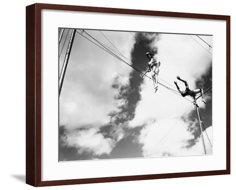 Male Trapeze Artist Hanging Upside Down Preparing To Catch Woman-H^ Armstrong Roberts-Framed Art Print