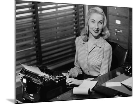 Secretary Sitting at Manual Typewriter, Portrait-George Marks-Mounted Photographic Print