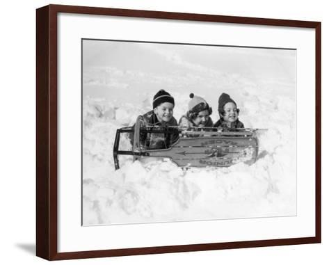 Two Girls and One Boy Lying on Belly in Snow Using Sled As Shield-H^ Armstrong Roberts-Framed Art Print
