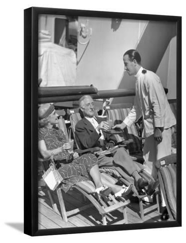 Elderly Couple Being Served Drinks on Deck of Cruise Ship-George Marks-Framed Art Print