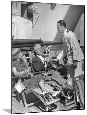Elderly Couple Being Served Drinks on Deck of Cruise Ship-George Marks-Mounted Photographic Print