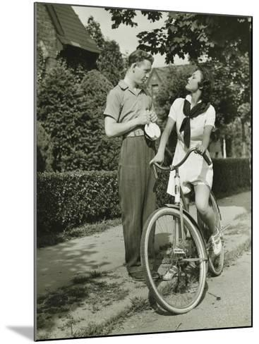 Young Couple Talking on Street, Woman on Bicycle-George Marks-Mounted Photographic Print