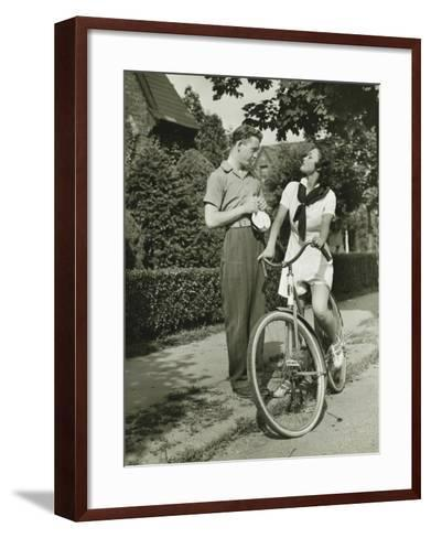 Young Couple Talking on Street, Woman on Bicycle-George Marks-Framed Art Print
