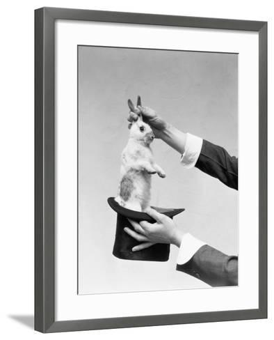 Hands of Magician Performing Magic Trick, Pulling Rabbit Out of Top Hat-H^ Armstrong Roberts-Framed Art Print