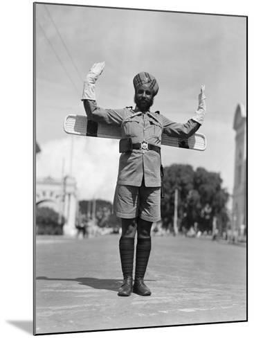 Sikh Traffic Policeman Standing in Middle of Street, Directing Traffic, Singapore-H^ Armstrong Roberts-Mounted Photographic Print