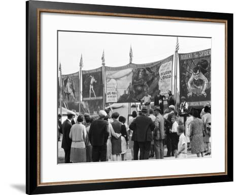 Crowd Watching Sideshow Performers in Front of Circus Posters, Outdoors-H^ Armstrong Roberts-Framed Art Print