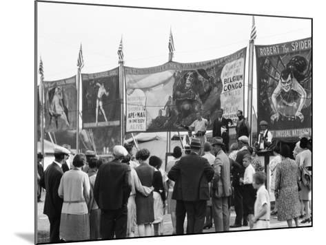 Crowd Watching Sideshow Performers in Front of Circus Posters, Outdoors-H^ Armstrong Roberts-Mounted Photographic Print