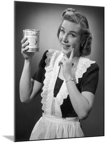 Housewife in Apron Holding a Can of Fruit-George Marks-Mounted Photographic Print
