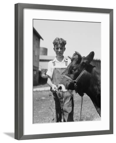 Teenage Farm Boy Wearing Bib Overalls, Holding Jersey Bull-H^ Armstrong Roberts-Framed Art Print