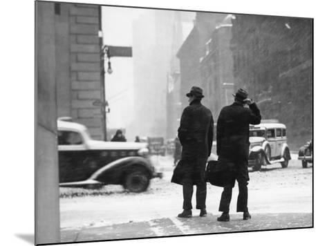 Two Men Walking on City Street in Snow-Storm-George Marks-Mounted Photographic Print
