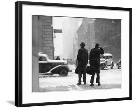 Two Men Walking on City Street in Snow-Storm-George Marks-Framed Art Print
