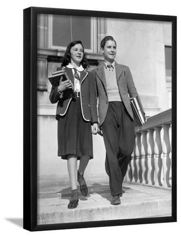 Teen Couple With Books Walking Outside School-George Marks-Framed Art Print