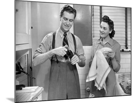Man Opening Can of Pop, Woman Drying Dishes-George Marks-Mounted Photographic Print
