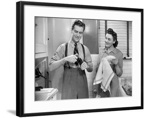 Man Opening Can of Pop, Woman Drying Dishes-George Marks-Framed Art Print