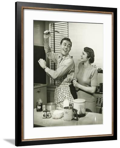 Young Cheerful Couple in Kitchen, Man in Apron-George Marks-Framed Art Print