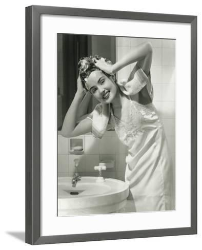 Portrait of Young Woman Washing Hair in Bathroom-George Marks-Framed Art Print