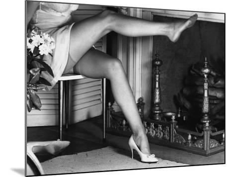 Woman Wearing Stockings Sitting By Fireplace-George Marks-Mounted Photographic Print