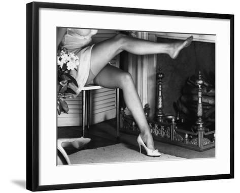 Woman Wearing Stockings Sitting By Fireplace-George Marks-Framed Art Print