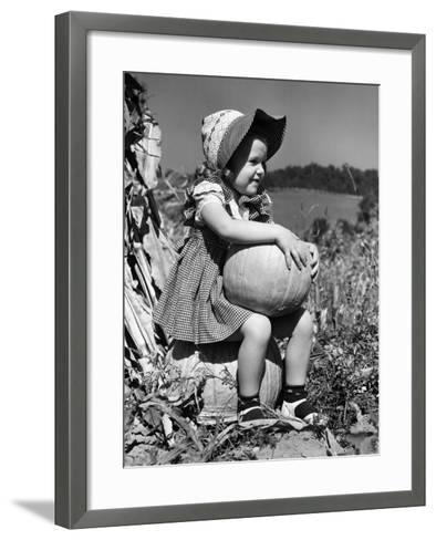 Girl Sitting on Pumpkin, Wearing Sun Bonnet-H^ Armstrong Roberts-Framed Art Print