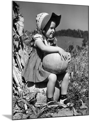 Girl Sitting on Pumpkin, Wearing Sun Bonnet-H^ Armstrong Roberts-Mounted Photographic Print