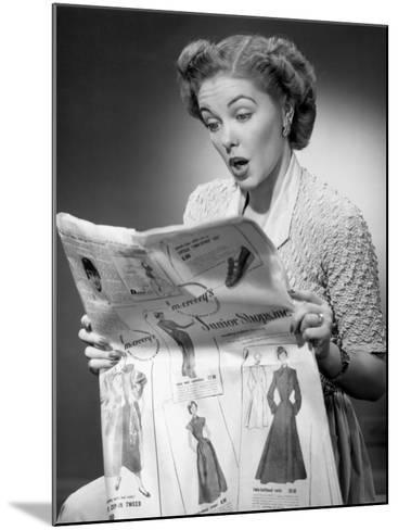 Woman Reading Newspaper With Look of Surprise-George Marks-Mounted Photographic Print