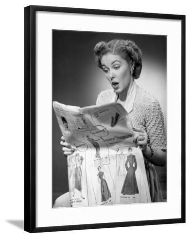 Woman Reading Newspaper With Look of Surprise-George Marks-Framed Art Print