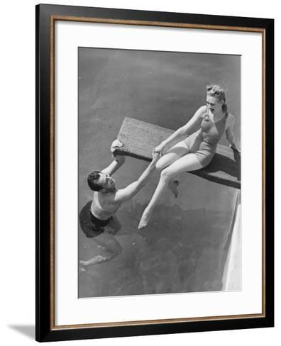 Woman Sitting on Diving Board, Man Grasping Her Hand-George Marks-Framed Art Print