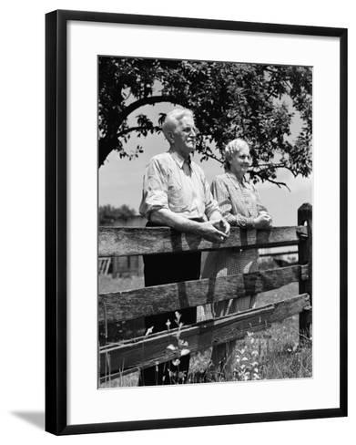 Elderly Couple on Farm Standing at Wooden Fence Looking Off Into Distance-H^ Armstrong Roberts-Framed Art Print