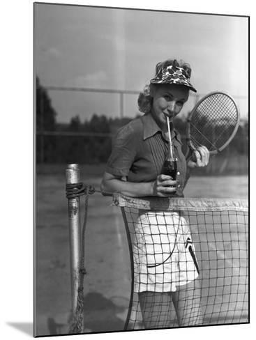Woman Drinking Cola at Tennis Net-George Marks-Mounted Photographic Print