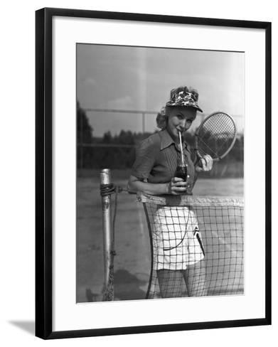 Woman Drinking Cola at Tennis Net-George Marks-Framed Art Print
