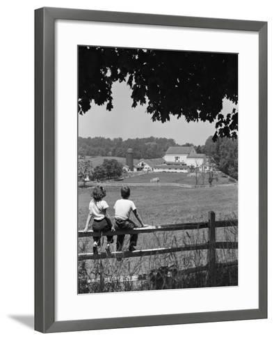 Boy and Girl Sitting on Fence, Overlooking Farm Fields-H^ Armstrong Roberts-Framed Art Print