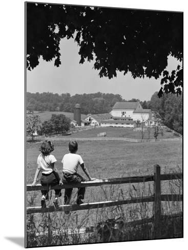 Boy and Girl Sitting on Fence, Overlooking Farm Fields-H^ Armstrong Roberts-Mounted Photographic Print