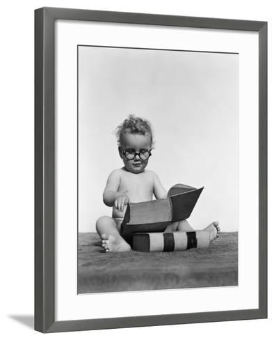 Baby Boy is Wearing Round Glasses While Reading a Very Large Book-H^ Armstrong Roberts-Framed Art Print