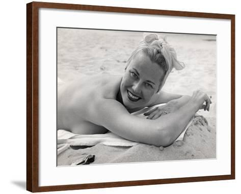 Woman Sunning and Smoking at Beach-George Marks-Framed Art Print